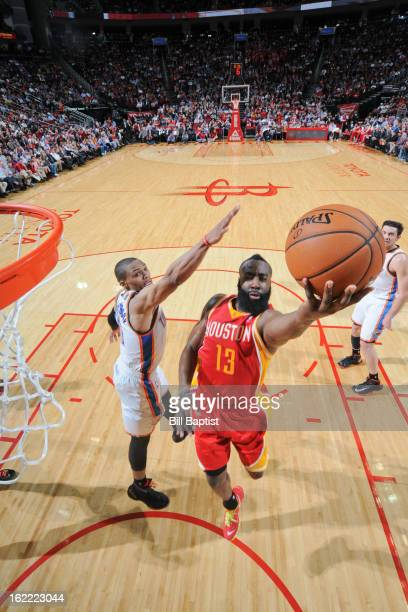 James Harden of the Houston Rockets shoots a layup against Russell Westbrook of the Oklahoma City Thunder on February 20 2013 at the Toyota Center in...