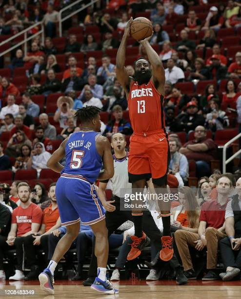 James Harden of the Houston Rockets shoots a three point basket over Dennis Smith Jr #5 of the New York Knicks during the first quarter at Toyota...