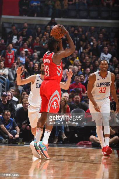 James Harden of the Houston Rockets shoots a three point basket over Wesley Johnson of the LA Clippers on February 28 2018 at STAPLES Center in Los...