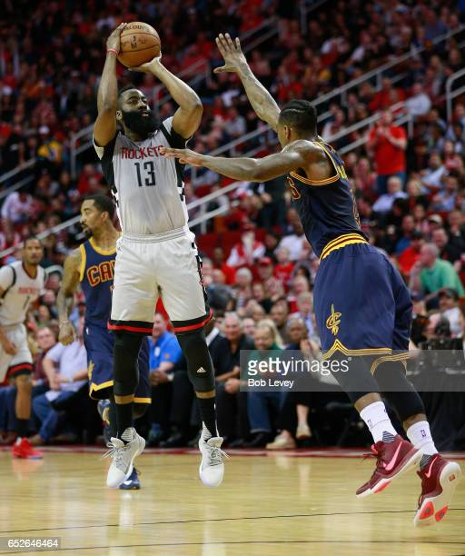 James Harden of the Houston Rockets shoots a three point shot over Iman Shumpert of the Cleveland Cavaliers at Toyota Center on March 12 2017 in...