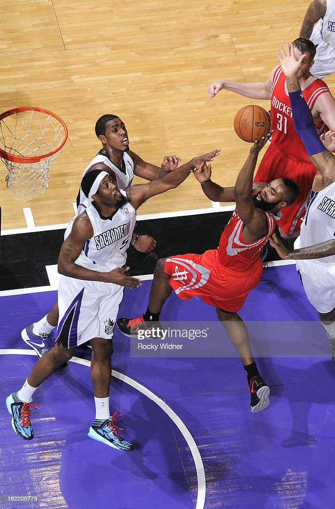 James Harden #13 of the Houston Rockets shoots against John Salmons #5 of the Sacramento Kings on February 10, 2013 at Sleep Train Arena in Sacramento, California.
