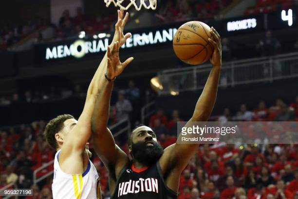 James Harden of the Houston Rockets shoots against Klay Thompson of the Golden State Warriors in the first quarter of Game Two of the Western...
