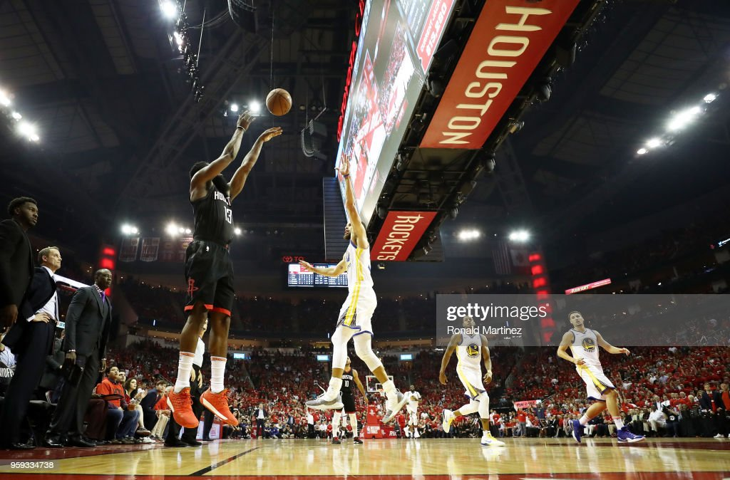 James Harden #13 of the Houston Rockets shoots against Stephen Curry #30 of the Golden State Warriors in the first half of Game Two of the Western Conference Finals of the 2018 NBA Playoffs at Toyota Center on May 16, 2018 in Houston, Texas.