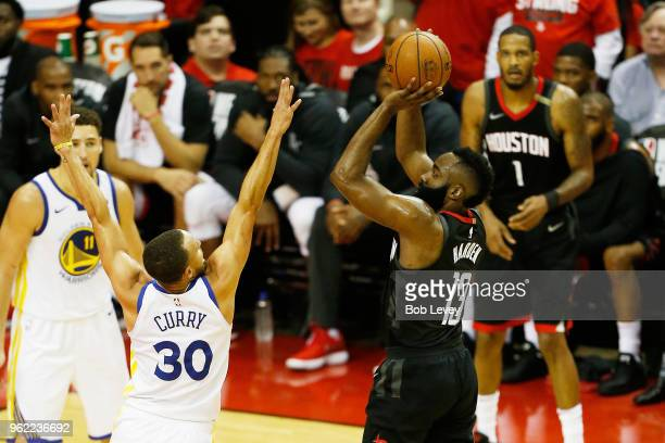 James Harden of the Houston Rockets shoots against Stephen Curry of the Golden State Warriors in the first half of Game Five of the Western...