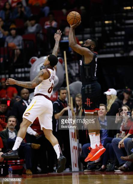 James Harden of the Houston Rockets shoots over Jordan Clarkson of the Cleveland Cavaliers during the second quarter at Toyota Center on January 11...