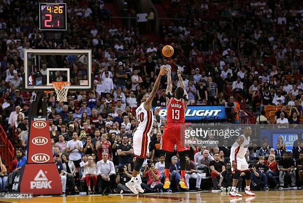 James Harden of the Houston Rockets shoots over Justise Winslow of the Miami Heat during a game at American Airlines Arena on November 1 2015 in...