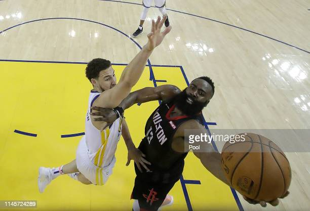 James Harden of the Houston Rockets shoots over Klay Thompson of the Golden State Warriors during Game One of the Second Round of the 2019 NBA...