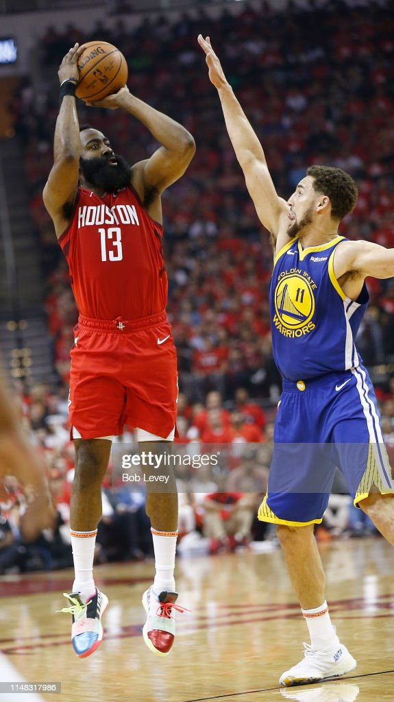 472d6aa8a56d James Harden of the Houston Rockets shoots over Klay Thompson of the ...