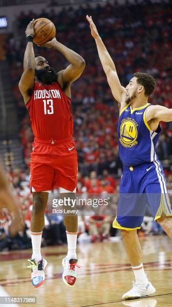 James Harden of the Houston Rockets shoots over Klay Thompson of the Golden State Warriors during Game Six of the Western Conference Semifinals of...