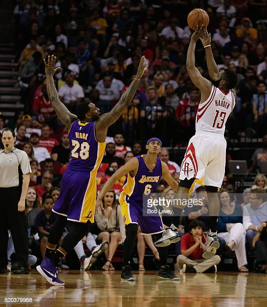 James Harden of the Houston Rockets shoots over Tarik Black of the Los Angeles Lakers and Jordan Clarkson at Toyota Center on April 10 2016 in...