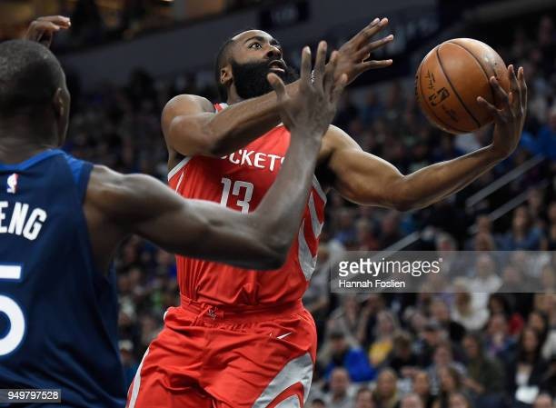 James Harden of the Houston Rockets shoots the ball against Gorgui Dieng of the Minnesota Timberwolves during the first quarter in Game Three of...