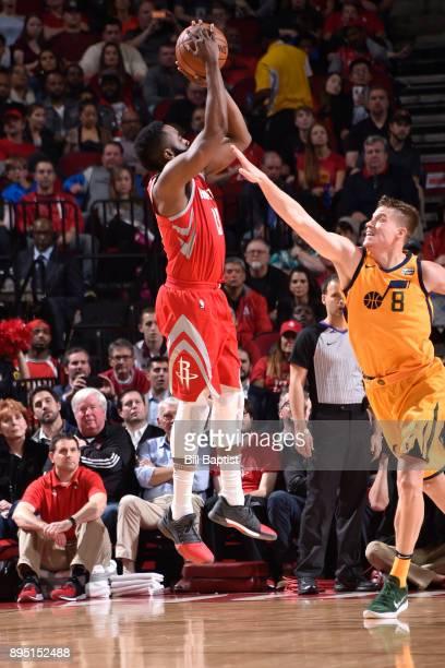 James Harden of the Houston Rockets shoots the ball against Jonas Jerebko of the Utah Jazz on December 18 2017 at the Toyota Center in Houston Texas...