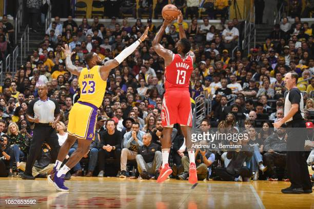 James Harden of the Houston Rockets shoots the ball against LeBron James of the Los Angeles Lakers on October 20 2018 at STAPLES Center in Los...