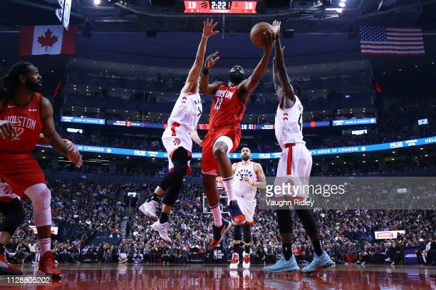 James Harden of the Houston Rockets shoots the ball as Jeremy Lin and Pascal Siakam of the Toronto Raptors defend during the first half of an NBA...