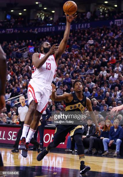 James Harden of the Houston Rockets shoots the ball as Kyle Lowry of the Toronto Raptors defends during the first half of an NBA game at Air Canada...