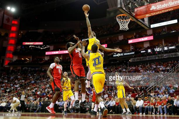 James Harden of the Houston Rockets shoots the ball over Marquese Chriss of the Golden State Warriors in the first half at Toyota Center on November...