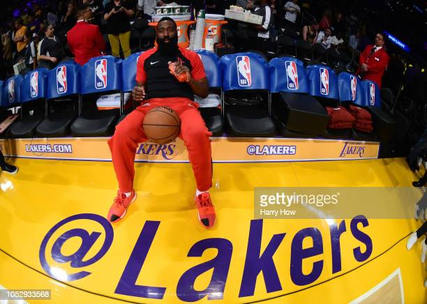 James Harden of the Houston Rockets sits alone on the bench before the game against the Los Angeles Lakers at Staples Center on October 20 2018 in...