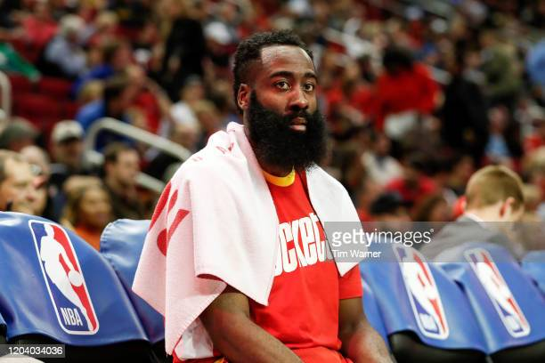 James Harden of the Houston Rockets sits on the bench in the first half against the Dallas Mavericks at Toyota Center on January 31, 2020 in Houston,...