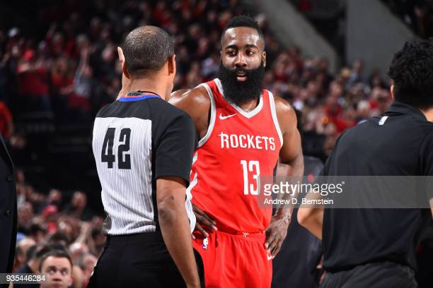 James Harden of the Houston Rockets speaks to referee Eric Lewis during the game against the Portland Trail Blazers on March 20 2018 at the Moda...