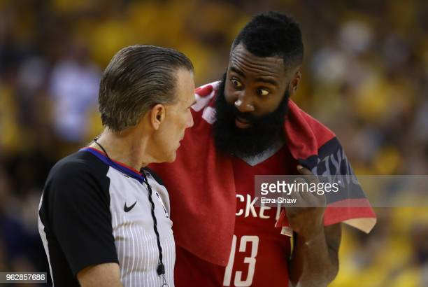 James Harden of the Houston Rockets speaks with referee Ken Mauer during Game Six of the Western Conference Finals in the 2018 NBA Playoffs against...