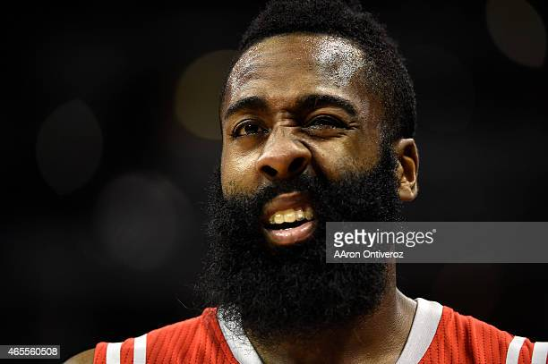 James Harden of the Houston Rockets squints after taking contact to his left eye from Kenneth Faried of the Denver Nuggets during the second half of...