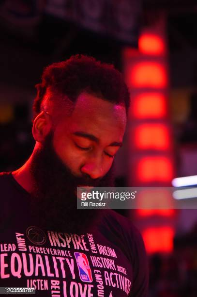 James Harden of the Houston Rockets stands for the National Anthem prior to a game against the Memphis Grizzlies on February 26 2020 at the Toyota...