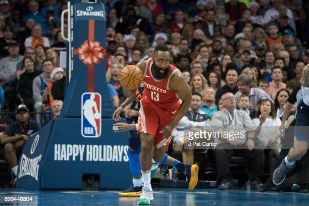 James Harden of the Houston Rockets steals the ball away Andre Roberson of the Oklahoma City Thunder during the second half of a NBA game at the...