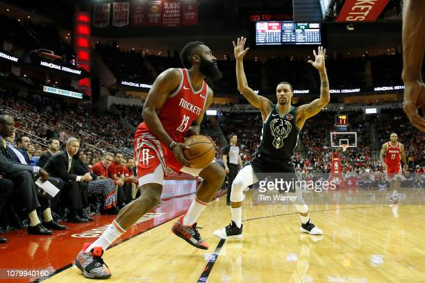 James Harden of the Houston Rockets steps back for a three point shot defended by George Hill of the Milwaukee Bucks in the second half at Toyota...