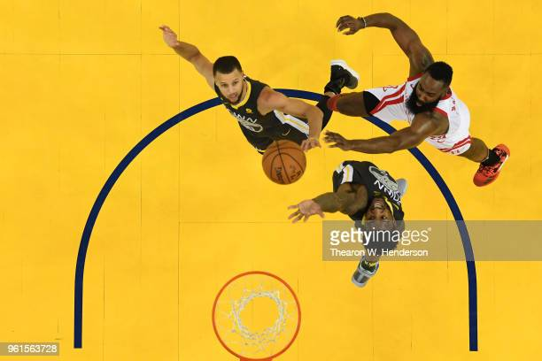 James Harden of the Houston Rockets takes a shot over Stephen Curry and Jordan Bell of the Golden State Warriors during Game Four of the Western...