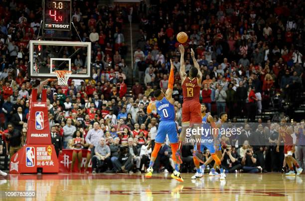 James Harden of the Houston Rockets takes a three point shot defended by Russell Westbrook of the Oklahoma City Thunder in the fourth quarter at...