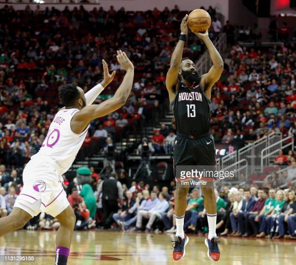James Harden of the Houston Rockets takes a three point shot defended by Josh Okogie of the Minnesota Timberwolves in the first half at Toyota Center...