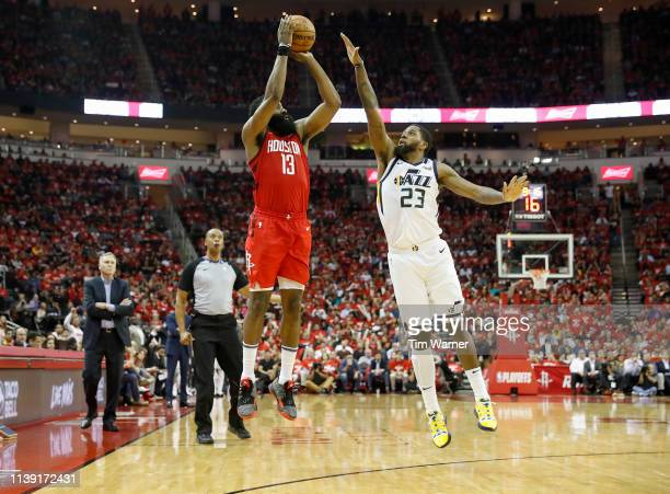 James Harden of the Houston Rockets takes a three point shot defended by Royce O'Neale of the Utah Jazz in the second half during Game Five of the...