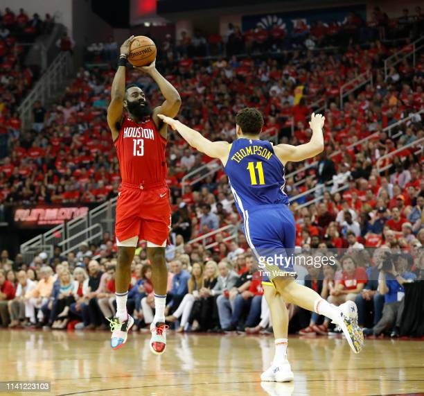 James Harden of the Houston Rockets takes a three point shot defended by Klay Thompson of the Golden State Warriors in the first half during Game...