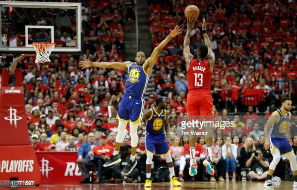 James Harden of the Houston Rockets takes a three point shot defended by Andre Iguodala of the Golden State Warriors in the fourth quarter during...
