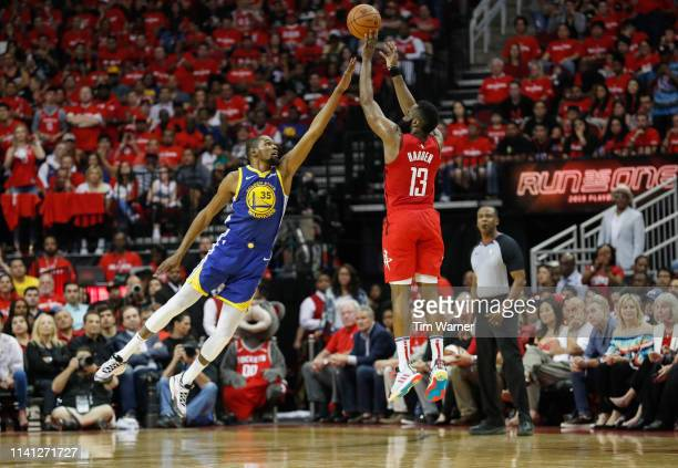 James Harden of the Houston Rockets takes a three point shot defended by Kevin Durant of the Golden State Warriors in the second half during Game...