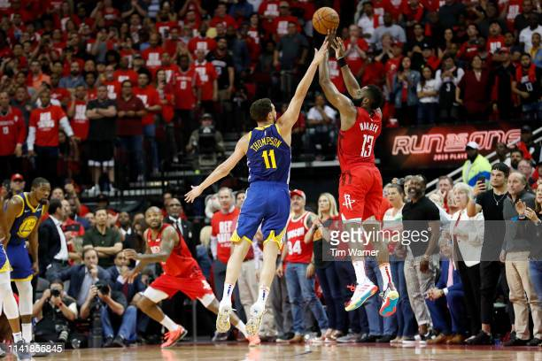 James Harden of the Houston Rockets takes a three point shot defended by Klay Thompson of the Golden State Warriors in the fourth quarter during Game...