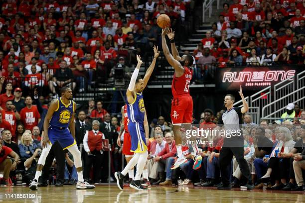 James Harden of the Houston Rockets takes a three point shot defended by Shaun Livingston of the Golden State Warriors in the fourth quarter during...