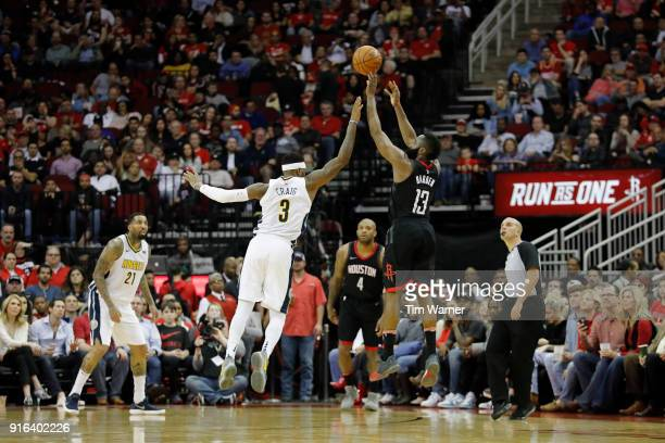 James Harden of the Houston Rockets takes a three point shot defended by Torrey Craig of the Denver Nuggets in the second half at Toyota Center on...