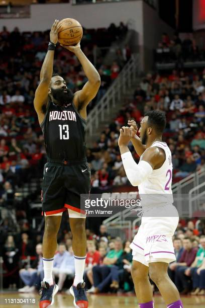 James Harden of the Houston Rockets takes a three point shot in the first half defended by Josh Okogie of the Minnesota Timberwolves at Toyota Center...