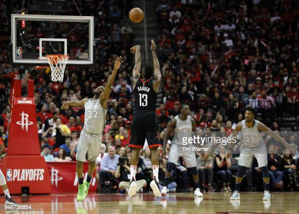 James Harden of the Houston Rockets takes a threepoint shot against Andrew Wiggins of the Minnesota Timberwolves in the second half during Game One...