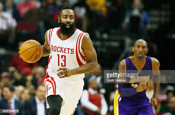 James Harden of the Houston Rockets takes the ball upcourt in front of Kobe Bryant of the Los Angeles Lakers during their game at the Toyota Center...