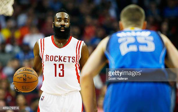 James Harden of the Houston Rockets takes the ball upcourt towards Chandler Parsons of the Dallas Mavericks during their game at the Toyota Center on...