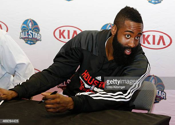 James Harden of the Houston Rockets talks to a fan in line while signing autographs at the Kia MVP Court during the 2014 NBA AllStar Jam Session at...