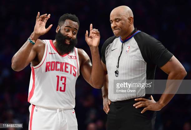 James Harden of the Houston Rockets talks to official Marat Kogut during the first half of their game against the Brooklyn Nets at Barclays Center on...