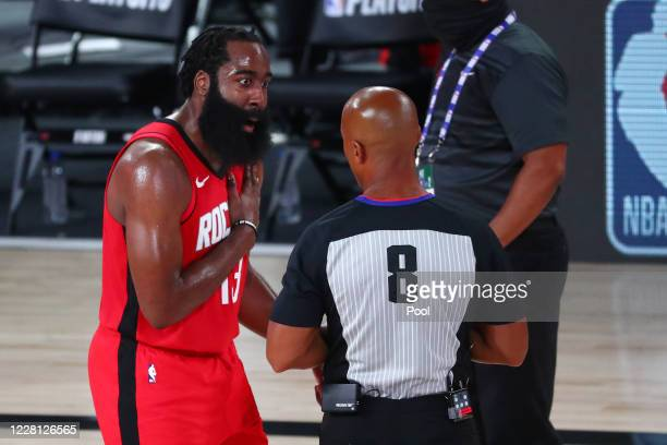 James Harden of the Houston Rockets talks with referee Marc Davis after the second quarter in game two in the first round of the 2020 NBA Playoffs at...