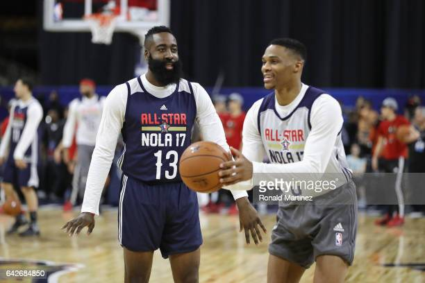 James Harden of the Houston Rockets talks with Russell Westbrook of the Oklahoma City Thunder during practice for the 2017 NBA AllStar Game at the...
