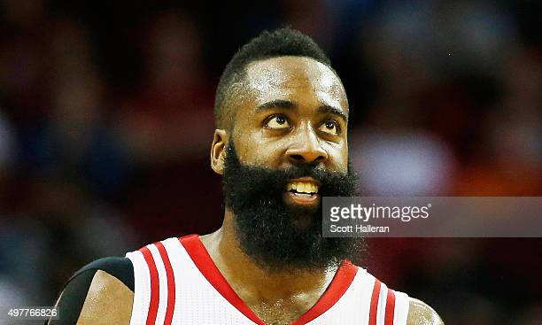 James Harden of the Houston Rockets walks on the court in the fourth quarter against the Portland Trail Blazers during their game at the Toyota...