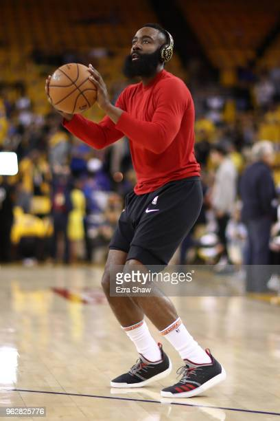 James Harden of the Houston Rockets warms up prior to Game Six of the Western Conference Finals in the 2018 NBA Playoffs against the Golden State...