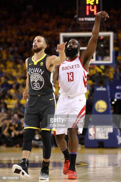 James Harden of the Houston Rockets watches his threepoint shot with Stephen Curry of the Golden State Warriors during Game Four of the Western...