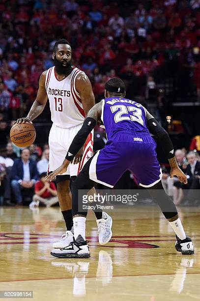 James Harden of the Houston Rockets works against Ben McLemore of the Sacramento Kings during the first half of a game at the Toyota Center on April...